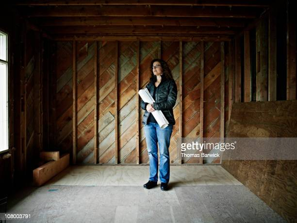 Home owner standing in home under construction