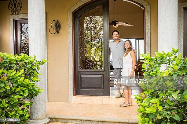 Home owners outside their home in Latin America