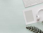"Home Pastel Office Desktop with keyboard, empty blank and headphones ""n"