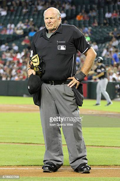 Home plate umpire and crew chief Bob Davidson waits for a drink of water during the Major League Baseball game between the Miami Marlins and Arizona...