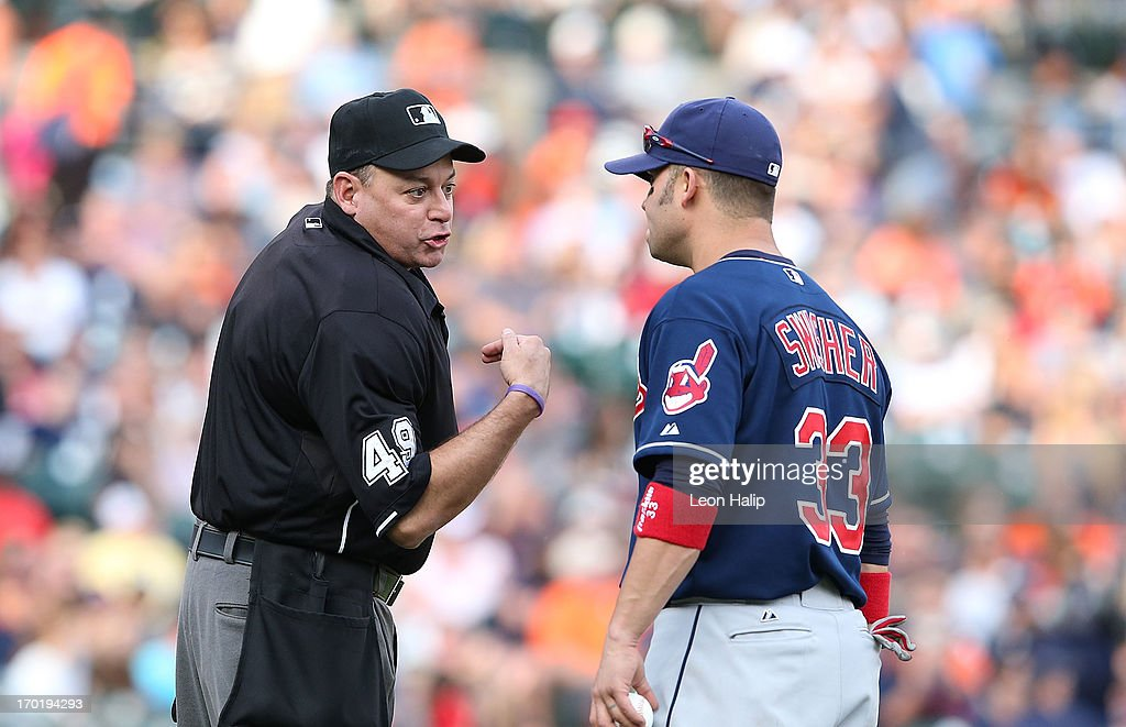 Home plate umpire Andy Fletcher and <a gi-track='captionPersonalityLinkClicked' href=/galleries/search?phrase=Nick+Swisher&family=editorial&specificpeople=206417 ng-click='$event.stopPropagation()'>Nick Swisher</a> #33 of the Cleveland Indians argue prior to the start of the eighth inning during the game against the Detroit Tigers at Comerica Park on June 8, 2013 in Detroit, Michigan. The Tigers defeated the Indians 6-4.