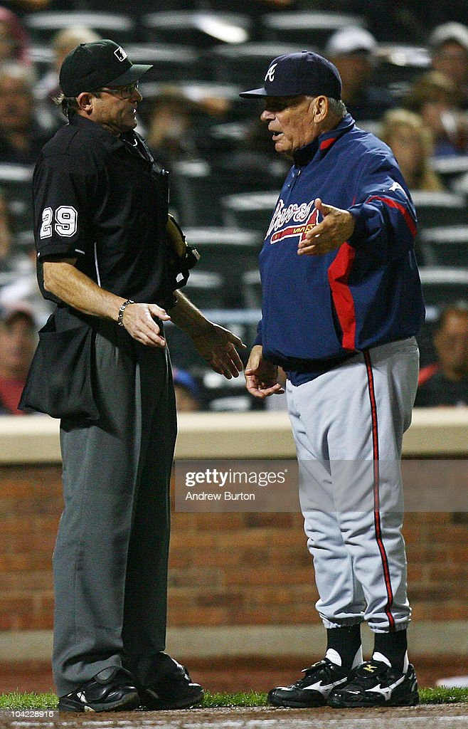 Home plate umpire Bill Hohn #29 argues with Bobby Cox of the Atlanta Braves during a game against the New York Mets on September 17, 2010 at Citi Field in the Flushing neighborhood of the Queens borough of New York City.