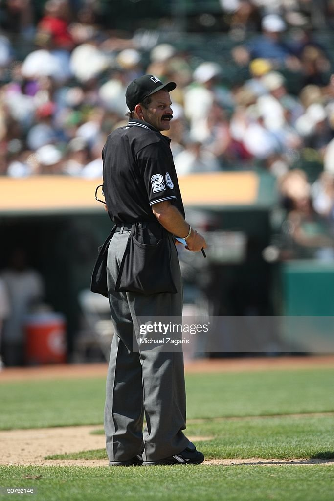 Home plate umpire Bill Hohn during the game against the Chicago White Sox during the 1929-themed turn back the clock game at the Oakland Coliseum in Oakland, California on August 16, 2009. The Athletics defeated the White Sox 3-2.