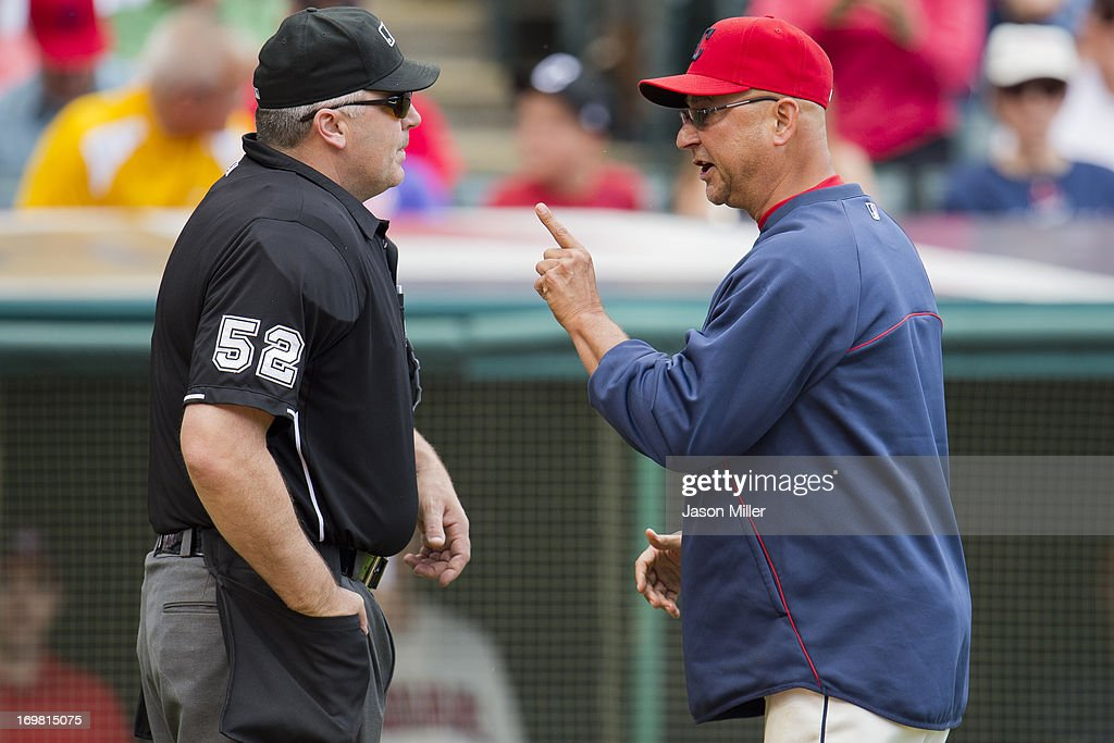 Home plate umpire Bill Welke #52 listens to manager <a gi-track='captionPersonalityLinkClicked' href=/galleries/search?phrase=Terry+Francona&family=editorial&specificpeople=171936 ng-click='$event.stopPropagation()'>Terry Francona</a> #17 of the Cleveland Indians argue during the fifth inning against the Tampa Bay Rays at Progressive Field on June 2, 2013 in Cleveland, Ohio.