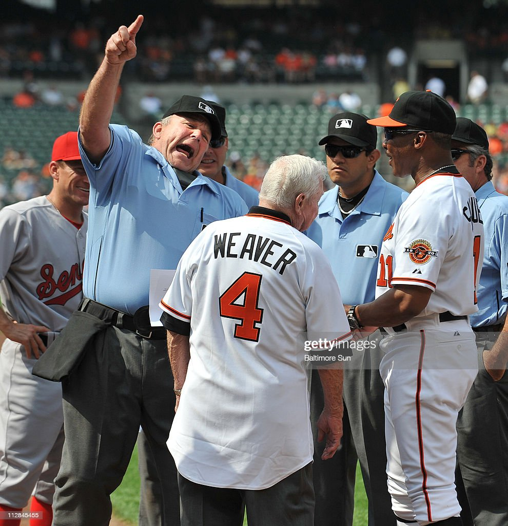 Home plate umpire Bob Davidson, pretends to throw former Orioles manager Earl Weaver out of the game, after Weaver and interim manager Juan Samuel brought out the lineup cards prior to the Orioles's game against the Washington Nationals at Oriole Park at Camden Yards in Baltimore, Maryland, Saturday, June 26, 2010. The Orioles defeated the Nationals, 6-5.