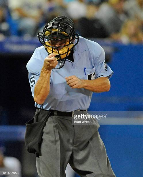 Home Plate Umpire Dale Scott calls a strike during MLB game action between the Toronto Blue Jays and the Baltimore Orioles September 15 2013 at...