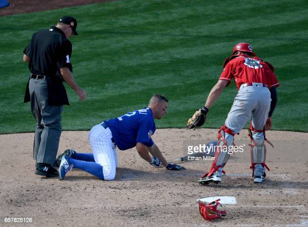 Home plate umpire Dan Bellino and Tucker Barnhart of the Cincinnati Reds check on John Andreoli of the Chicago Cubs after he was hit by a pitch from...