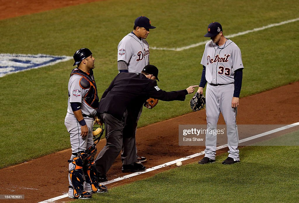 Home plate umpire Dan Iassogna (C) signals fair ball as catcher Gerald Laird #9, Miguel Cabrera #24 and Drew Smyly #33 of the Detroit Tigers look on on a ball bunted by Gregor Blanco #7 of the San Francisco Giants in the seventh inning during Game Two of the Major League Baseball World Series at AT&T Park on October 25, 2012 in San Francisco, California.