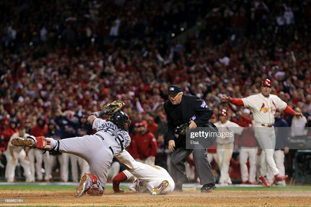 Home plate umpire Dana DeMuth #32 calls <a gi-track='captionPersonalityLinkClicked' href=/galleries/search?phrase=Allen+Craig&family=editorial&specificpeople=4405049 ng-click='$event.stopPropagation()'>Allen Craig</a> #21 of the St. Louis Cardinals safe at home as <a gi-track='captionPersonalityLinkClicked' href=/galleries/search?phrase=Jarrod+Saltalamacchia&family=editorial&specificpeople=836404 ng-click='$event.stopPropagation()'>Jarrod Saltalamacchia</a> #39 of the Boston Red Sox reacts in the ninth inning of Game Three of the 2013 World Series at Busch Stadium on October 26, 2013 in St Louis, Missouri.