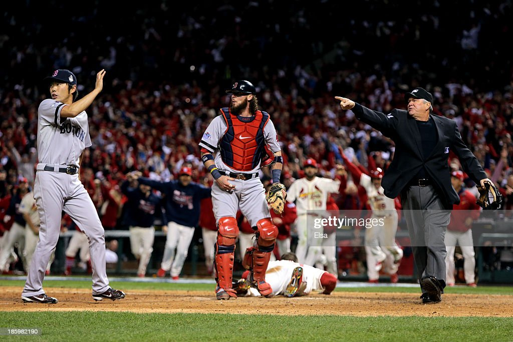 Home plate umpire Dana DeMuth #32 calls <a gi-track='captionPersonalityLinkClicked' href=/galleries/search?phrase=Allen+Craig&family=editorial&specificpeople=4405049 ng-click='$event.stopPropagation()'>Allen Craig</a> #21 of the St. Louis Cardinals safe at home as <a gi-track='captionPersonalityLinkClicked' href=/galleries/search?phrase=Jarrod+Saltalamacchia&family=editorial&specificpeople=836404 ng-click='$event.stopPropagation()'>Jarrod Saltalamacchia</a> #39 and <a gi-track='captionPersonalityLinkClicked' href=/galleries/search?phrase=Koji+Uehara&family=editorial&specificpeople=801278 ng-click='$event.stopPropagation()'>Koji Uehara</a> #19 of the Boston Red Sox react in the ninth inning of Game Three of the 2013 World Series at Busch Stadium on October 26, 2013 in St Louis, Missouri.