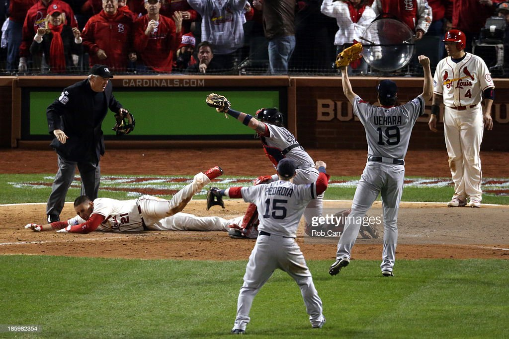 Home plate umpire Dana DeMuth #32 calls <a gi-track='captionPersonalityLinkClicked' href=/galleries/search?phrase=Allen+Craig&family=editorial&specificpeople=4405049 ng-click='$event.stopPropagation()'>Allen Craig</a> #21 of the St. Louis Cardinals safe at home against <a gi-track='captionPersonalityLinkClicked' href=/galleries/search?phrase=Jarrod+Saltalamacchia&family=editorial&specificpeople=836404 ng-click='$event.stopPropagation()'>Jarrod Saltalamacchia</a> #39 of the Boston Red Sox as <a gi-track='captionPersonalityLinkClicked' href=/galleries/search?phrase=Dustin+Pedroia&family=editorial&specificpeople=836339 ng-click='$event.stopPropagation()'>Dustin Pedroia</a> and #15 <a gi-track='captionPersonalityLinkClicked' href=/galleries/search?phrase=Koji+Uehara&family=editorial&specificpeople=801278 ng-click='$event.stopPropagation()'>Koji Uehara</a> #19 of the Boston Red Sox react in the ninth inning during Game Three of the 2013 World Series at Busch Stadium on October 26, 2013 in St Louis, Missouri.