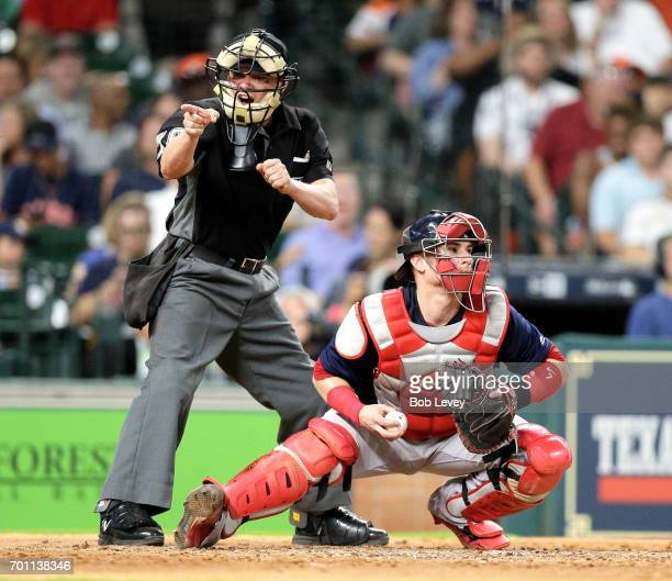 Home plate umpire DJ Reyburn calls a strike as Christian Vazquez of the Boston Red Sox prepares to throw the ball back at Minute Maid Park on June 16...