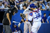 TORONTO ON MAY 5 Home plate umpire Ed Hickox and Alex Rodriguez of the New York Yankees duck as Russell Martin of the Toronto Blue Jays takes a lob...