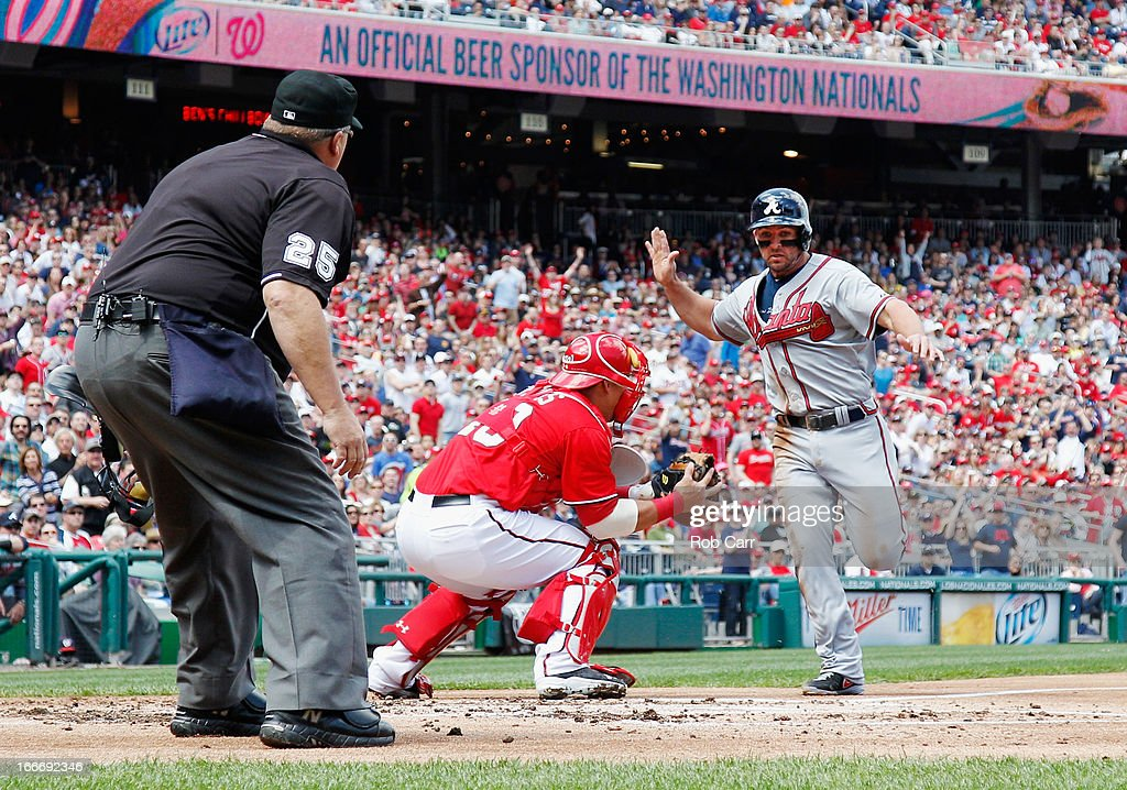 Home plate umpire Fieldin Culbreth watches as catcher <a gi-track='captionPersonalityLinkClicked' href=/galleries/search?phrase=Wilson+Ramos&family=editorial&specificpeople=4866956 ng-click='$event.stopPropagation()'>Wilson Ramos</a> #40 of the Washington Nationals tags out <a gi-track='captionPersonalityLinkClicked' href=/galleries/search?phrase=Dan+Uggla&family=editorial&specificpeople=542208 ng-click='$event.stopPropagation()'>Dan Uggla</a> #26 of the Atlanta Braves trying to score at Nationals Park on April 13, 2013 in Washington, DC.