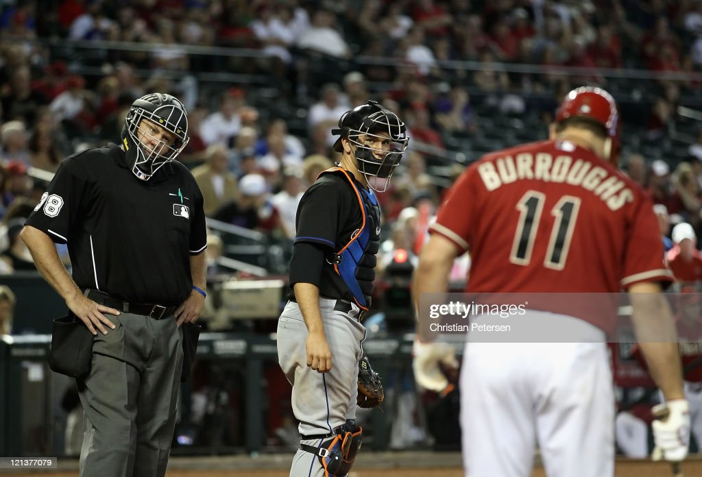 Home plate umpire Gary Cederstrom reacts to Sean Burroughs #11 of the Arizona Diamondbacks as he bats against the New York Mets during the Major League Baseball game at Chase Field on August 14, 2011 in Phoenix, Arizona. The Diamondbacks defeated the Mets 5-3.