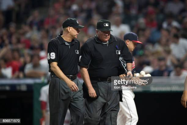 Home plate umpire Hunter Wendelstedt walks to the Indians dugout with umpire Andy Fletcher as he leaves the game after being hit in the head with a...