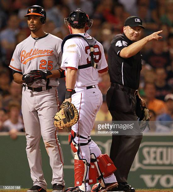 Home plate umpire Jeff Nelson warns both benches after Baltimore Orioles first baseman Derrek Lee was struck by a pitch from Boston Red Sox starting...
