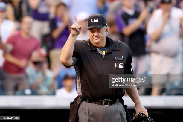 Home plate umpire Joe West acknowledges the crowd after being recognized in the middle of the fifth ining for his 5000th game during the Colorado...