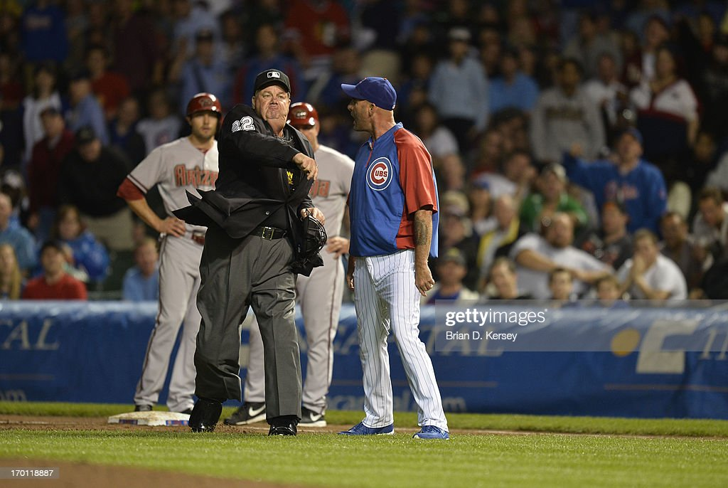Home plate umpire Joe West throws out manager Dale Sveum of the Chicago Cubs during the game against the Arizona Diamondbacks at Wrigley Field on...