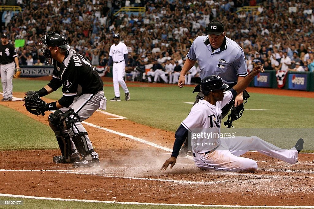 Home plate umpire Joe West watches catcher A.J. Pierzynski #12 of the Chicago White Sox take a late throw as B.J. Upton #13 of the Tampa Bay Rays scores in Game 1 of the American Leaugue Divisional Series at Tropicana Field on October 2, 2008 in St. Petersburg, Florida. The Rays defeated the White Sox 6-4.