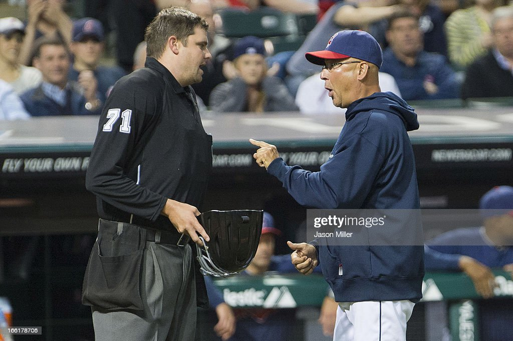 Home plate Umpire Jordan Baker #71argues with Terry Francona #17 of the Cleveland Indians after Baker ejected starting pitcher Carlos Carrasco #59 for throwing at Kevin Youkilis #36 of the New York Yankees during the fourth inning at Progressive Field on April 9, 2013 in Cleveland, Ohio.