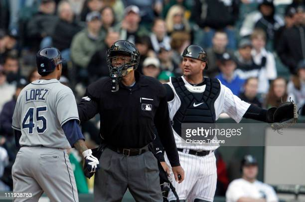 Home plate umpire Kerwin Danley separates Tampa Bay Rays' Felipe Lopez and Chicago White Sox catcher AJ Pierzynski after the two players exchanged...