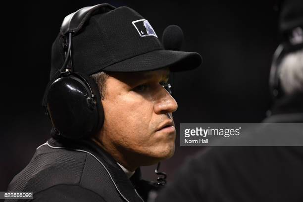 Home plate umpire Larry Vanover listens on the headset for a replay ruling during a game between the Arizona Diamondbacks and the Atlanta Braves at...