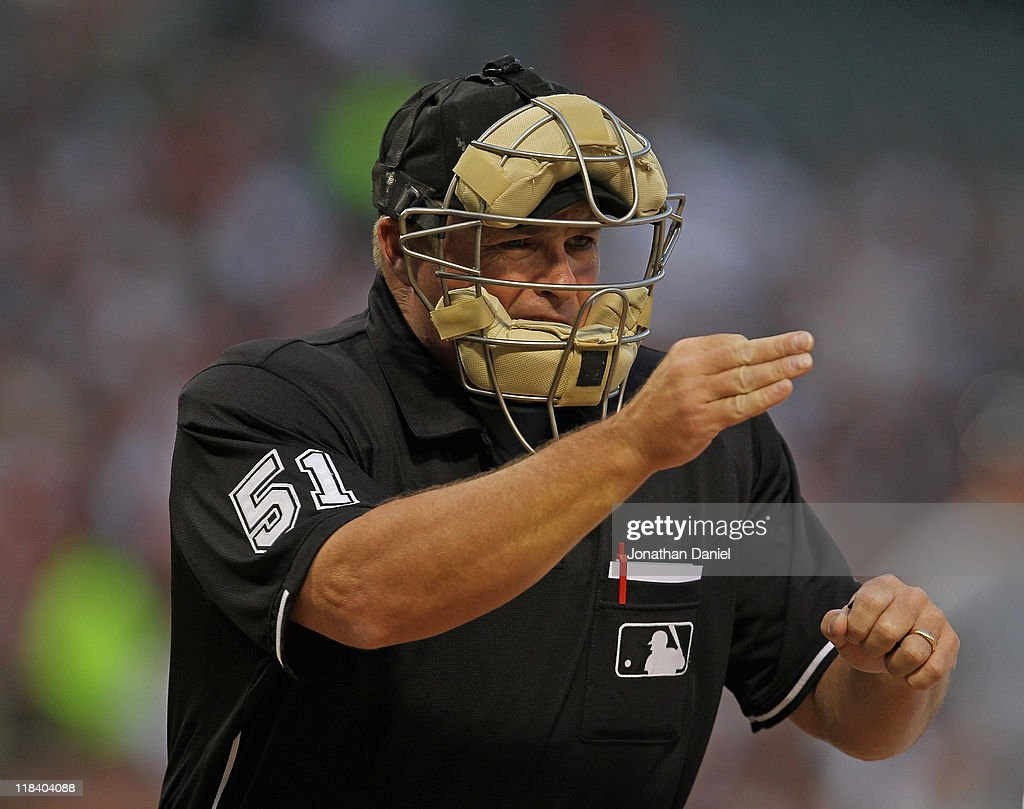 Home plate umpire Marvin Hudson #51 calls a strike during a game between the Chicago White Sox and the Seattle Mariners at U.S. Cellular Field on June 8, 2011 in Chicago, Illinois. The Mariners defeated the White Sox 7-4 in 10 innings.
