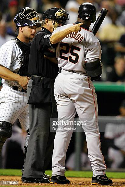 Home plate umpire Mike Reilly sends Barry Bonds of the San Francisco Giants to first base after being hit by a pitch from Brian Fuentes of the...