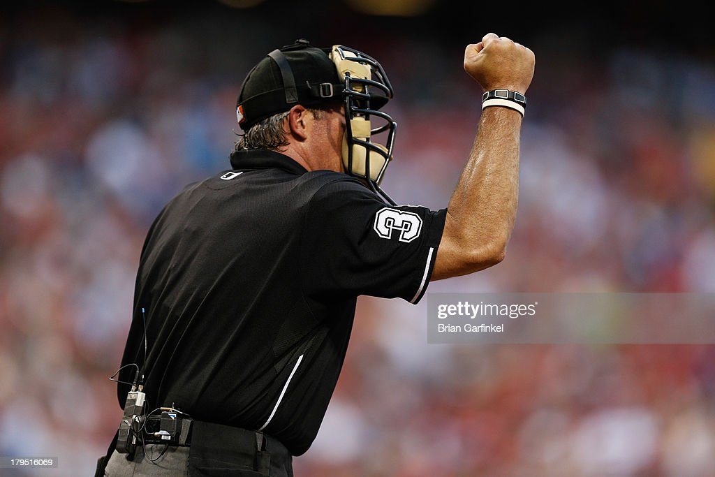 Home plate umpire Paul Nauert calls a strike during the game between the Atlanta Braves and the Philadelphia Phillies at Citizens Bank Park on July 6...