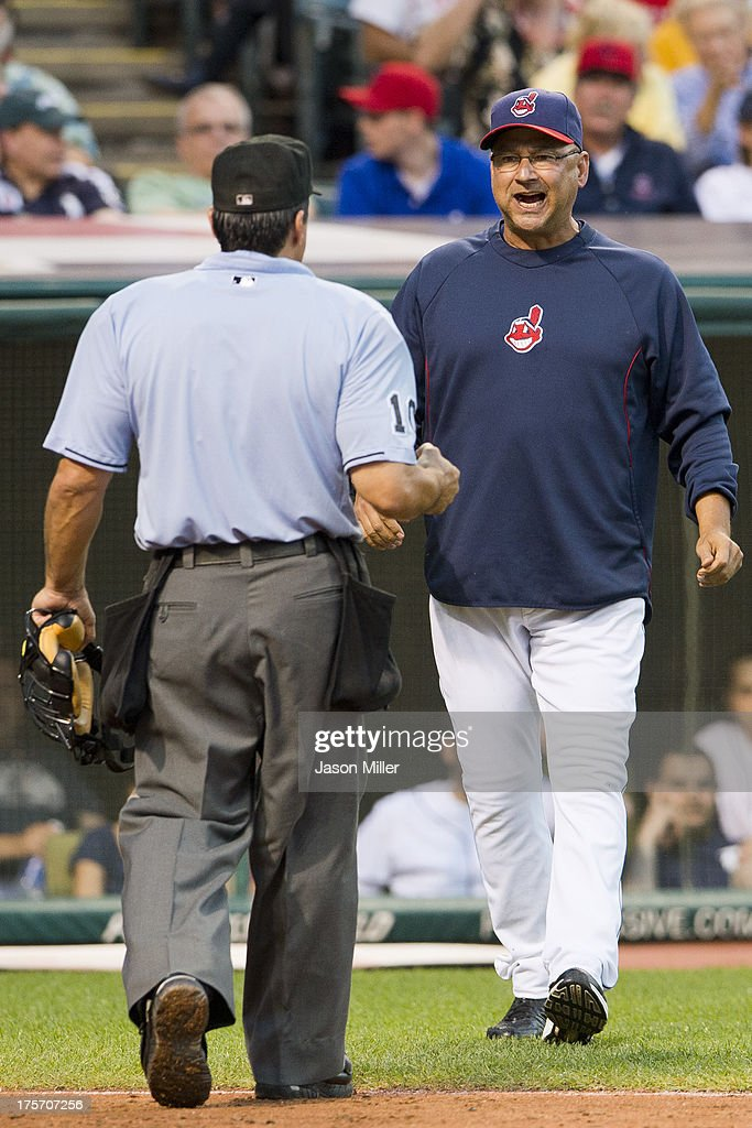 Home plate umpire <a gi-track='captionPersonalityLinkClicked' href=/galleries/search?phrase=Phil+Cuzzi&family=editorial&specificpeople=260231 ng-click='$event.stopPropagation()'>Phil Cuzzi</a> #10 talks with <a gi-track='captionPersonalityLinkClicked' href=/galleries/search?phrase=Terry+Francona&family=editorial&specificpeople=171936 ng-click='$event.stopPropagation()'>Terry Francona</a> #17 of the Cleveland Indians during the fifth inning against the Detroit Tigers at Progressive Field on August 6, 2013 in Cleveland, Ohio.