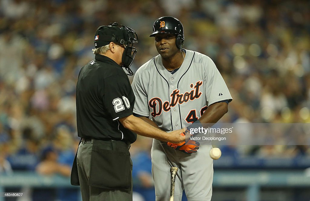 Home plate umpire <a gi-track='captionPersonalityLinkClicked' href=/galleries/search?phrase=Rob+Drake&family=editorial&specificpeople=247242 ng-click='$event.stopPropagation()'>Rob Drake</a> #30 speaks to <a gi-track='captionPersonalityLinkClicked' href=/galleries/search?phrase=Torii+Hunter&family=editorial&specificpeople=183408 ng-click='$event.stopPropagation()'>Torii Hunter</a> #48 of the Detroit Tigers after calling Hunter out on strikes in the third inning during the MLB game against the Los Angeles Dodgers at Dodger Stadium on April 8, 2014 in Los Angeles, California.