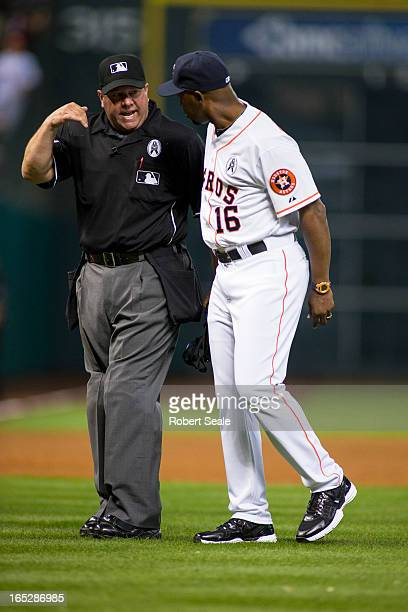 Home plate umpire Sam Holbrook talks with manager Bo Porter of the Houston Astros after reviewing the Justin Maxwell triple during the game against...