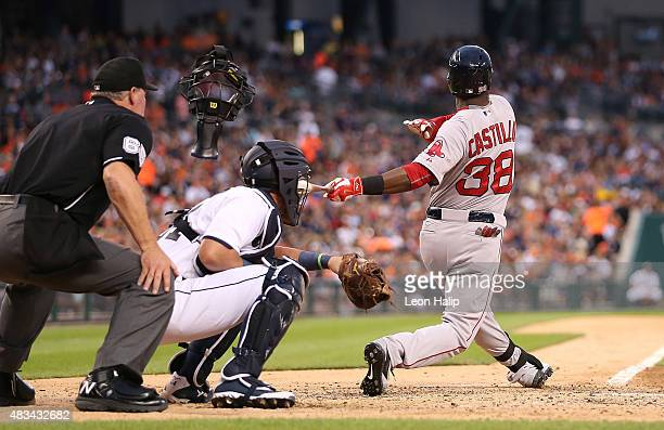 Home plate umpire Ted Barrett's mask gets knocked off by a foul ball from Rusney Castillo of the Boston Red Sox during the fifth inning of the game...