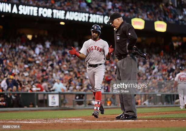 Home plate umpire Tim Timmons waits to make sure that Chris Young of the Boston Red Sox touches home plate after he hit a home run against the San...