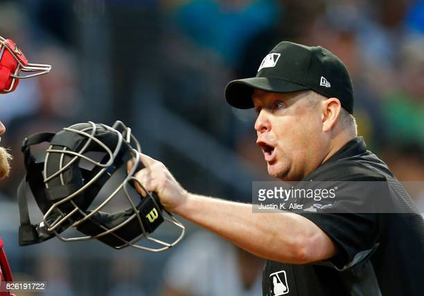 Home plate umpire Todd Tichenor yells during the Cincinnati Reds against the Pittsburgh Pirates at PNC Park on August 3 2017 in Pittsburgh...