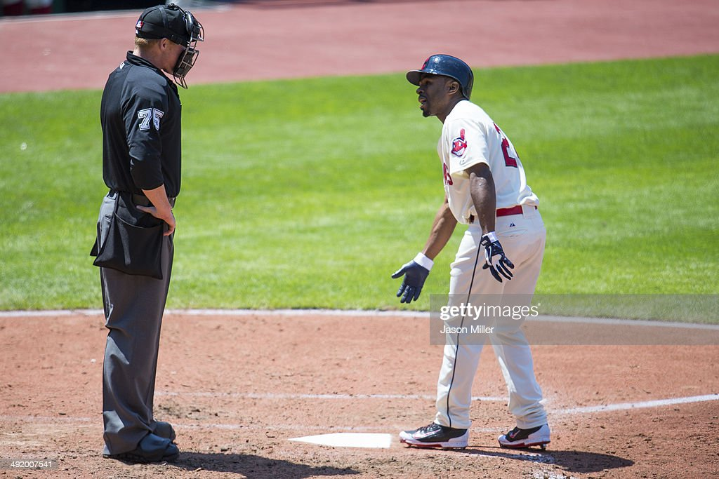 Home plate umpire Tom Woodring listens to Michael Bourn of the Cleveland Indians argue after he struck out to end the fourth inning against the...