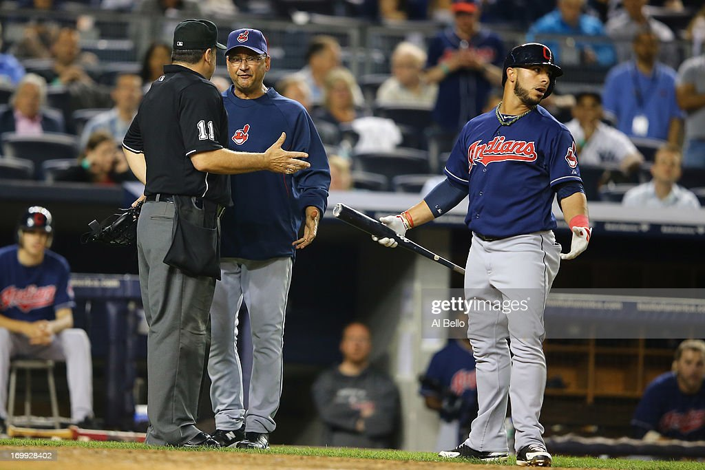 Home plate Umpire Tony Randazzo argues with <a gi-track='captionPersonalityLinkClicked' href=/galleries/search?phrase=Terry+Francona&family=editorial&specificpeople=171936 ng-click='$event.stopPropagation()'>Terry Francona</a> #17 of the Cleveland Indians as <a gi-track='captionPersonalityLinkClicked' href=/galleries/search?phrase=Mike+Aviles&family=editorial&specificpeople=4944765 ng-click='$event.stopPropagation()'>Mike Aviles</a> #4 looks on over a strike call in the ninth inning against the New York Yankees during their game on June 4, 2013 at Yankee Stadium in the Bronx borough of New York City