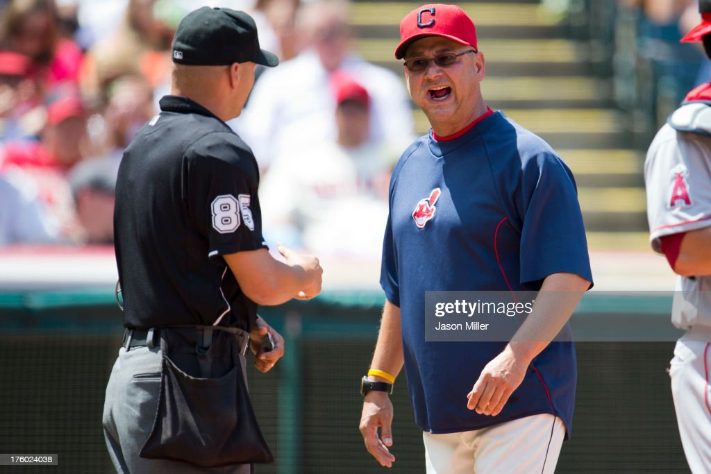 Home plate umpire Vic Carapazza #85 listens to <a gi-track='captionPersonalityLinkClicked' href=/galleries/search?phrase=Terry+Francona&family=editorial&specificpeople=171936 ng-click='$event.stopPropagation()'>Terry Francona</a> #17 of the Cleveland Indians after Asdrubal Cabrera #13 was ejected for arguing balls and strikes during the second inning against the Los Angeles Angels of Anaheim at Progressive Field on August 11, 2013 in Cleveland, Ohio.
