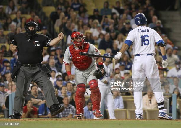 MLB home plate umpire Wally Bell calls Andre Ethier of the Los Angeles Dodgers out on strikes to end the eighth inning as catcher Carlos Ruiz of the...