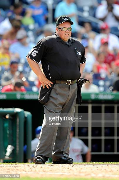 Home plate umpire Wally Bell rests during a break in the game between the New York Mets and the Washington Nationals at Nationals Park on July 26...