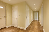 Reception Hall within new property with several doors and wooden flooring