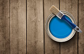 Paint can on the old wooden background with copy space