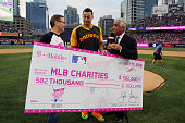 Home Run Derby Champion Giancarlo Stanton of the Miami Marlins receives a check from Mike Sievert Chief Operating Officer of TMobile after winning...