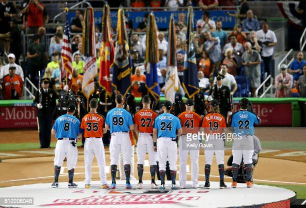 Home Run Derby Participants pose for a photo on the stage prior to the 2017 TMobile Home Run Derby at Marlins Park on Monday July 10 2017 in Miami...