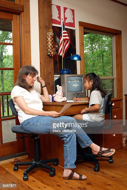 A home schooling mother Lisa McLean teaches a spelling lesson to her adopted daughter Maddie in the family's school room April 22 2004 in Shreveport...