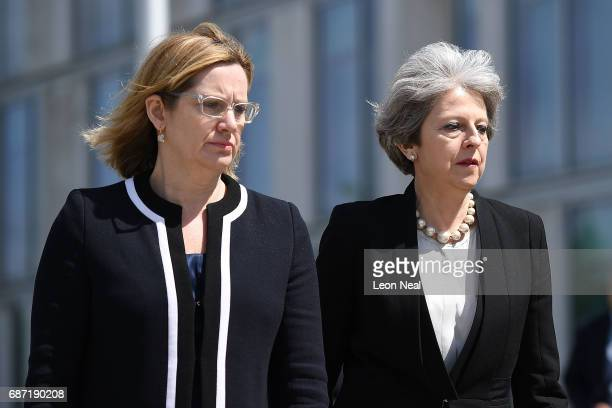 Home Secretary Amber Rudd and Britain's Prime Minister Theresa May make their way to meet Chief Constable of Greater Manchester Police Ian Hopkins on...