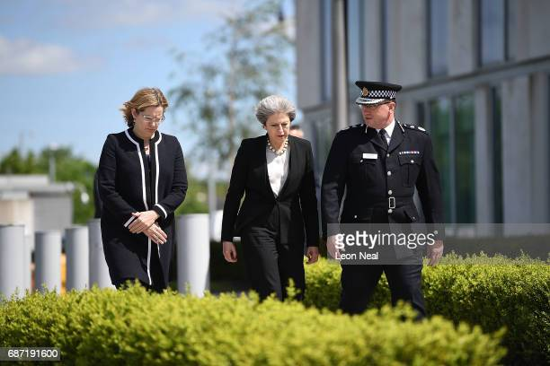 Home Secretary Amber Rudd and Britain's Prime Minister Theresa May meet Chief Constable of Greater Manchester Police Ian Hopkins on May 23 2017 in...