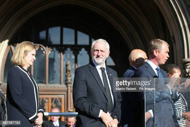 Home Secretary Amber Rudd Labour leader Jeremy Corbyn and Liberal Democrat leader Tim Farron during a vigil in Albert Square Manchester after a...