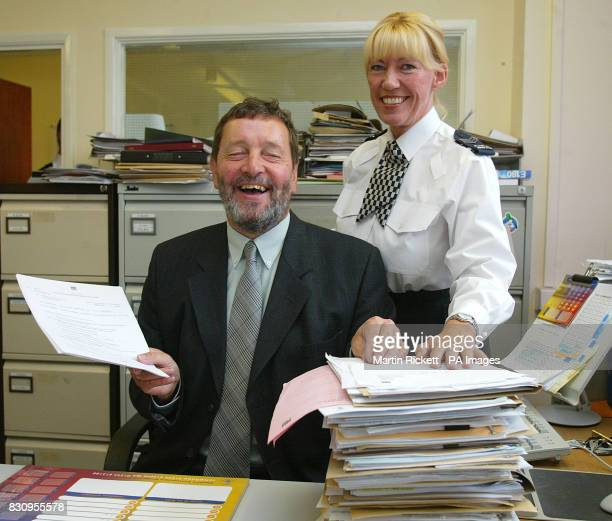 Home Secretary David Blunkett is shown a pile of police paperwork by Sergeant Anne Boothby during his visit to Chester Police Station in Cheshire *...